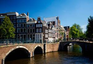 Summer Shot of a Bridge and Houses in Amsterdam, Netherlands