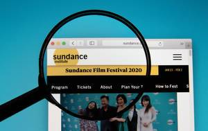 Sundance Film Festival logo on a computer screen with a magnifying glass