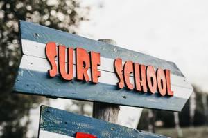 Surf school wooden sight. Outdoor background