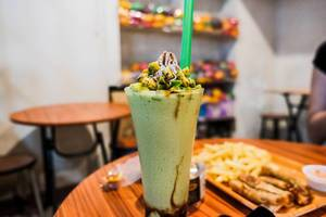 Sweet avocado smoothie with fresh avocado slices