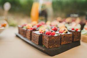 Sweet Brownie Squares With Various Berries On Top