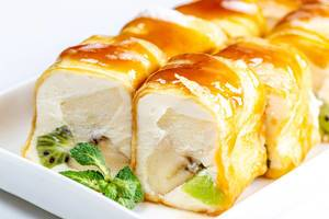 Sweet rolls with cheese, fruit and mint leaves