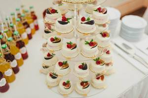 Sweet White Mini Cakes On A Transparent Stand