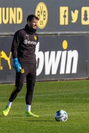 Swiss goalkeeper of Borussia Dortmund, Roman Bürki, with the ball during a public training