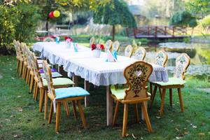 Table and chairs arranged for outdoor children party