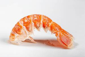 Tail of a boiled lobster on a white background close-up