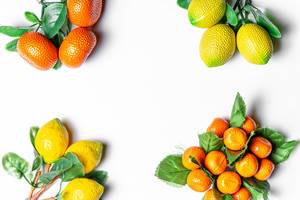 Tangerines and lemons with leaves on a white background with free space (Flip 2020)