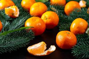 Tangerines with Christmas tree branches on a black background (Flip 2019)