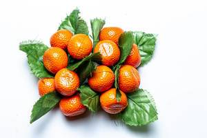 Tangerines with leaves fridge magnets on a white background (Flip 2020)