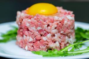 Tartare with egg yolk