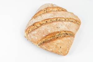 Tasty rustic bread isolated above white background