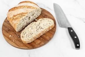 Tasty rustic bread sliced on the wooden board (Flip 2019)