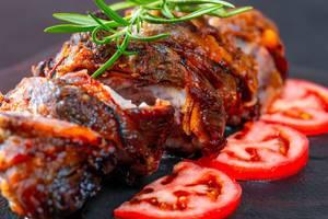 Tasty slices baked meatloaf on table