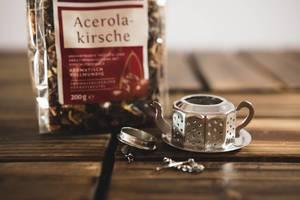 Tea dispenser with tea bag over a wooden surface