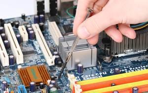 Technician repairing broken computer