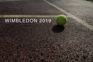 "Tennis ball located on a tennis court next to the name of the London sports event ""Wimbledon 2019"""