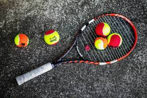 Tennis racket with training balls