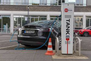 "Tesla Model S at a German ""RheinEnergie"" charging station for electric cars in front of the Cologne public transport company KVB"