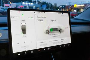 Tesla Supercharging board computer in the car during the charging phase