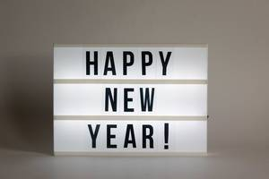 Text on luminous panel wishes a happy new year!