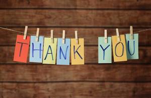 Thank you cards hanging on a rope with clothes peg