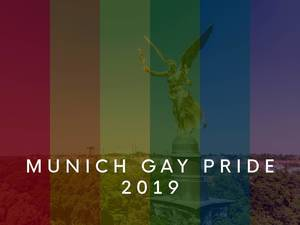 "The angel of peace ""Friedensengel"" behind rainbow flags to celebrate Munich Gay Pride Parade 2019 during CSD"