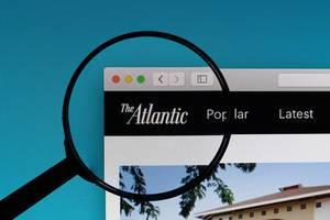 The Atlantic logo under magnifying glass