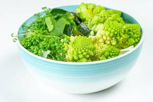 The concept of healthy diet food. Salad with avocado, romanesco cabbage and watercress (Flip 2020)
