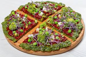 The concept of healthy food. Pizza with vegetables and micro greens cabbage (Flip 2019)