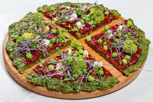 The concept of healthy food. Pizza with vegetables and micro greens cabbage