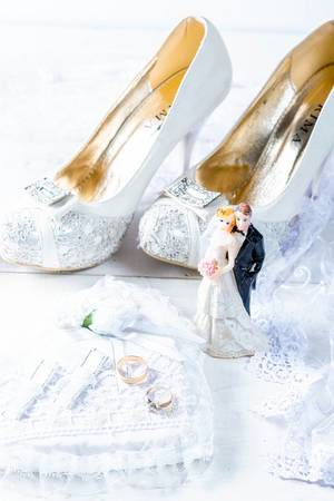 The concept of preparation for the wedding with white shoes and gold rings