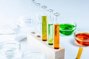 The concept of studying chemistry. Test tubes and reagents on a white background (Flip 2020)