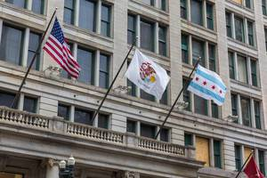 """The flags of the US, of the State of Illinois and of the City of Chicago blowing in the """"Windy city"""""""