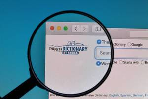 The Free Dictionary logo under magnifying glass