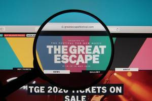 The Great Escape Festival website on a computer screen with a magnifying glass