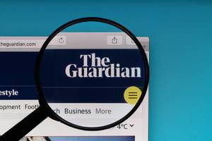 The Guardian logo under magnifying glass