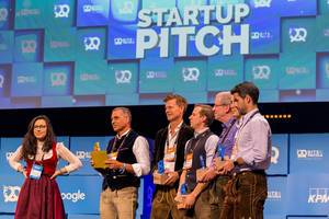 The jury of investors in traditional Oktoberfest costumes prepares to announce the name of the winner after the startup pitch at Bits & Pretzels 2019