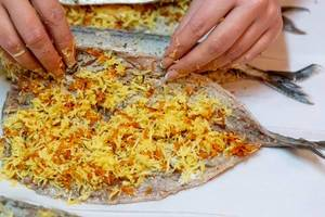 The process of cooking Mackerel with cheese. Preparation for baking