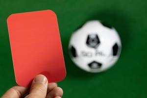 The referee in red card gesture