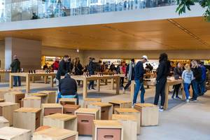 The special architecture of the Apple flagship store on the Chicago Riverfront attracts crowds of visitors every day