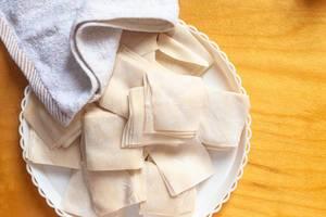 The stack of dough cut into a rectangle shape. Dough for cooking dumplings