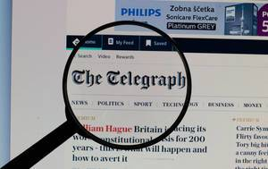 The Telegraph logo on a computer screen with a magnifying glass