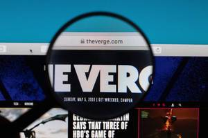The Verge website under magnifying glass