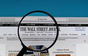 The Wall Street Journal logo under magnifying glass