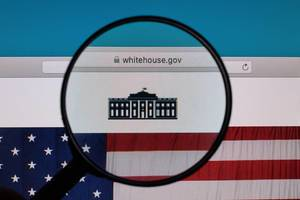 The White House website under magnifying glass