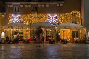 The with christmas lights decorated Mimi e Coco wine bar in Rome