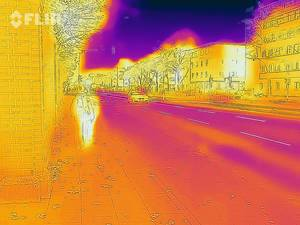 Thermal image of a street, including passerby and car - FLIR infrared camera / iPhone