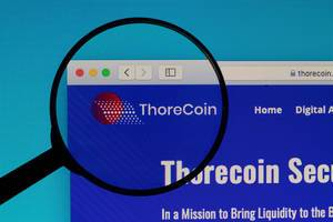 ThoreCoin logo under magnifying glass