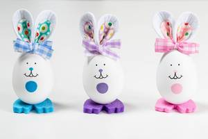 Three Easter bunnies made from eggs on a white background
