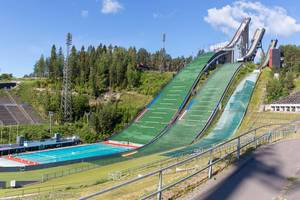 Three empty ski jumps in the ski jumping facility for skiers, near the sports centre during summer season in Lahti, Finland